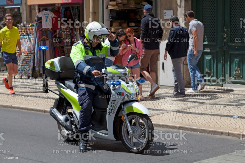 Officer of the Polícia Municipal on his scooter stock photo