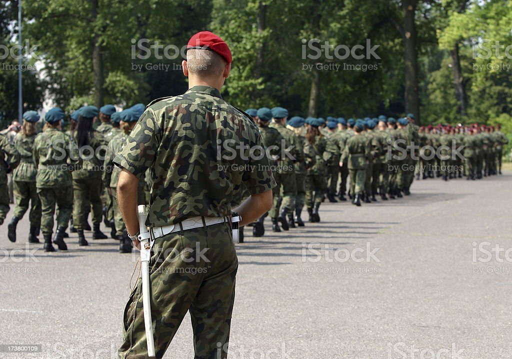 officer overseeing new recruits royalty-free stock photo