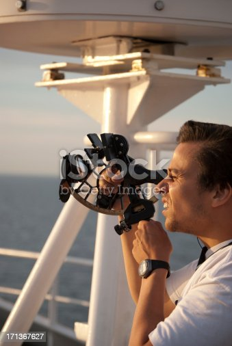 Officer using a sextant on board a big cargo ship.You might also like