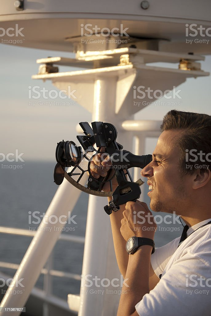 Officer using sextant on board a ship stock photo