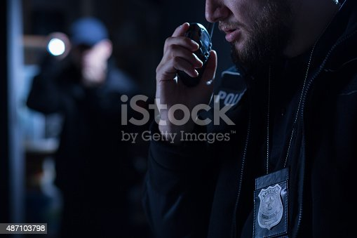 istock Officer using walkie talkie 487103798