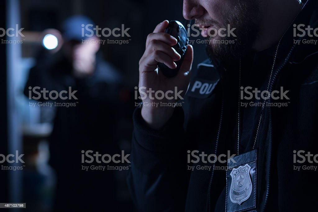 Officer using walkie talkie stock photo