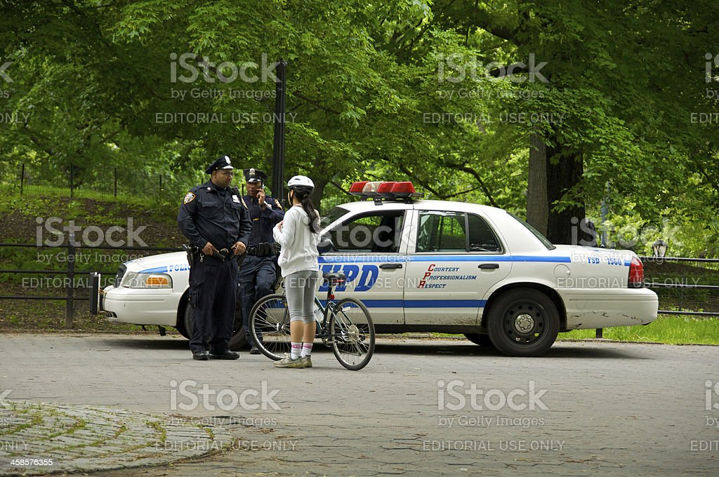 NYPD officer with female bicyclist, Central Park, NYC stock photo