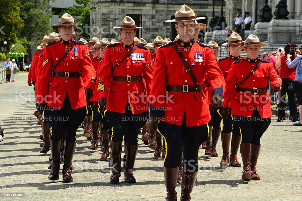 RCMP officers marching in red uniforms. stock photo