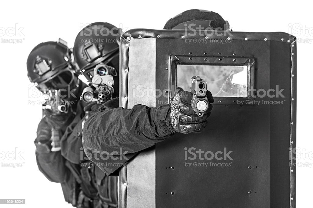 SWAT officers  with ballistic shield stock photo