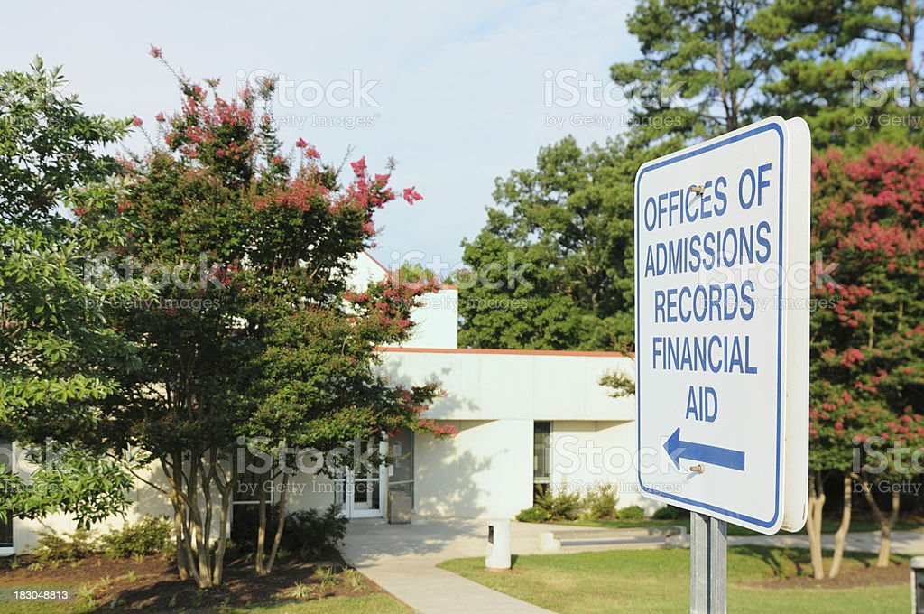 Offices of admissions records financial aid directional sign stock photo