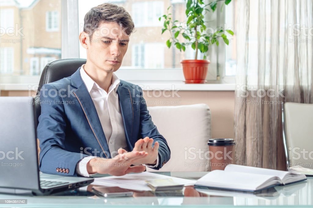 Official businessman sitting at workplace in office refuses bribes. Concept of corruption and bribery stock photo