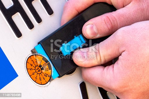 istock TÜV official checking the vehicle. removed old plaque 1148793498
