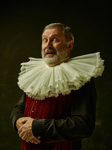 istock Official portrait of historical governor from the golden age. Studio shot against dark wall. 1084468044