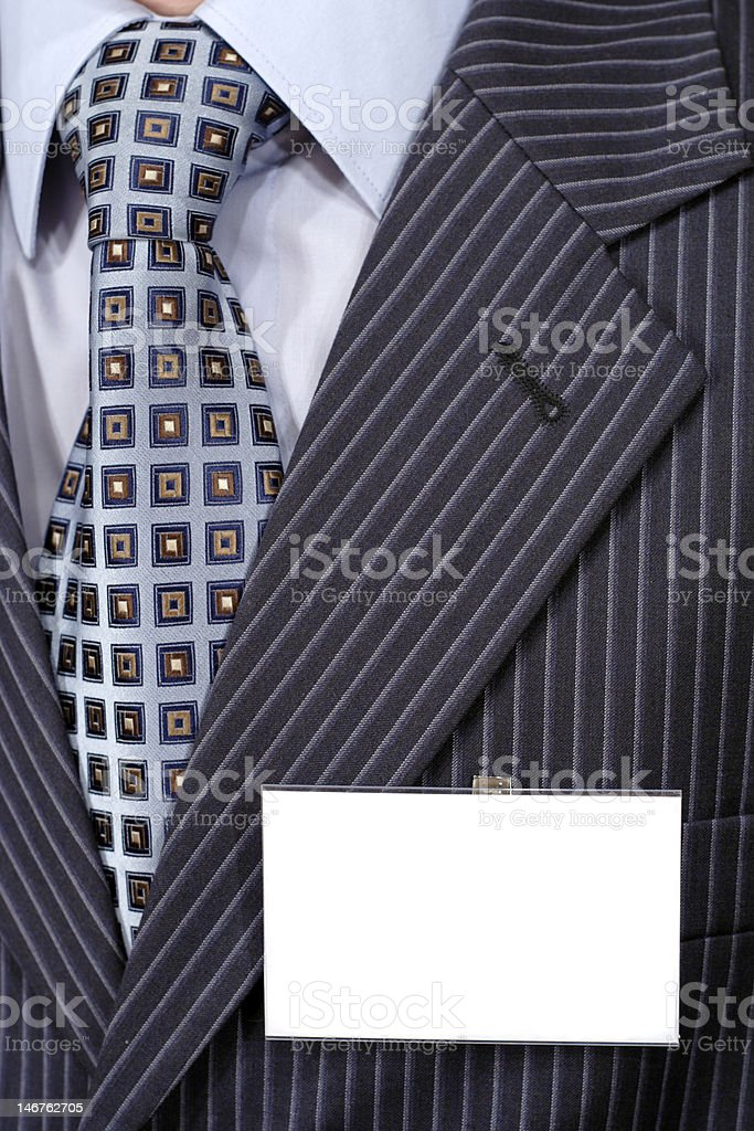 Official suit fragment with blank badge on it royalty-free stock photo
