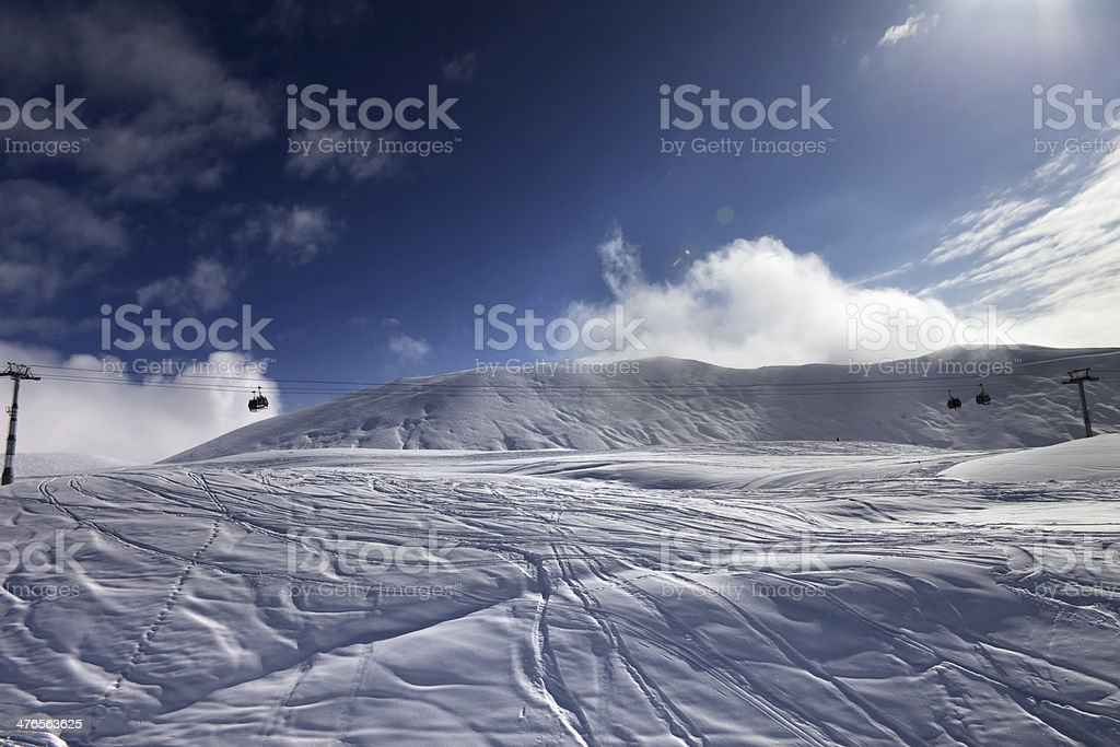 Off-piste ski slope and gondola lift royalty-free stock photo