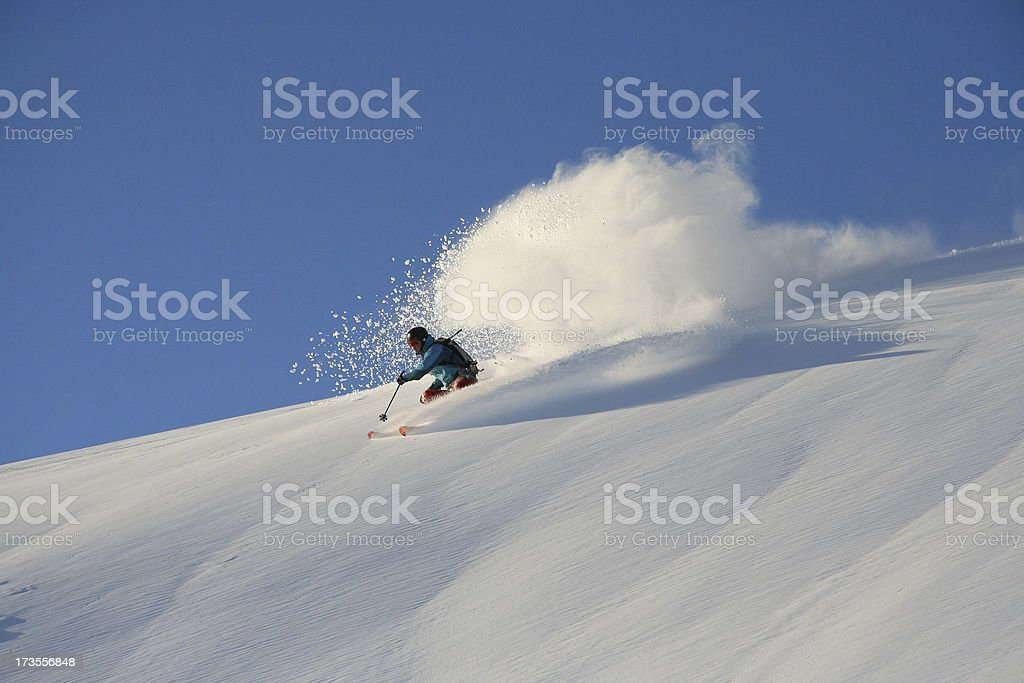 Off-piste skiing in powder snow stock photo