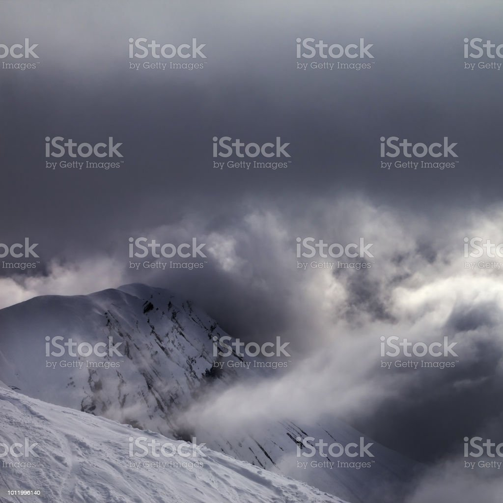 Off-piste slope and snowy rocks in bad weather. Georgia, region...