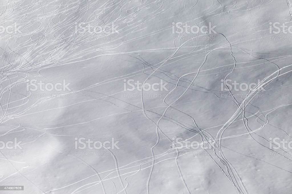 Off-piste slope with traces of skis and snowboarding stock photo
