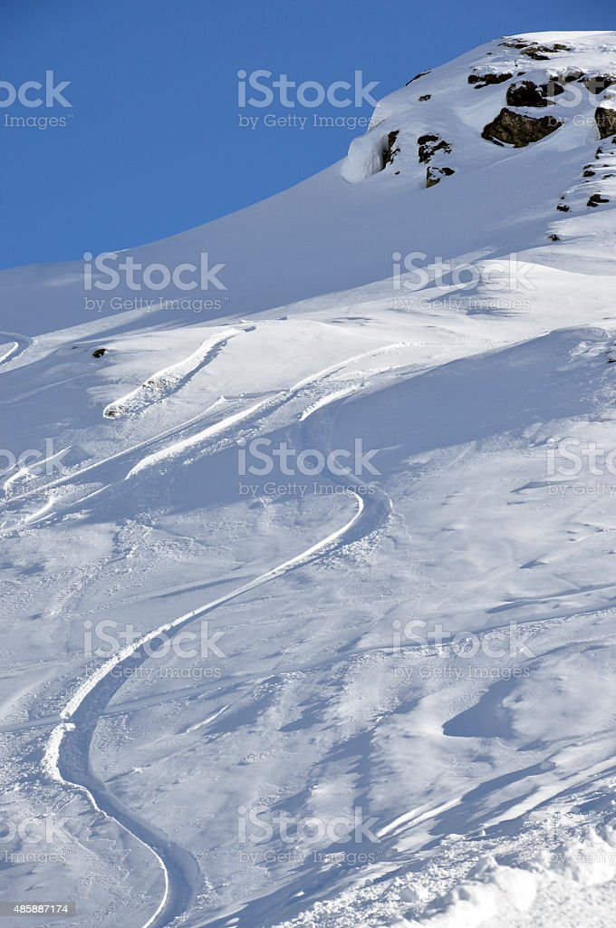 Off-piste snowboard track stock photo