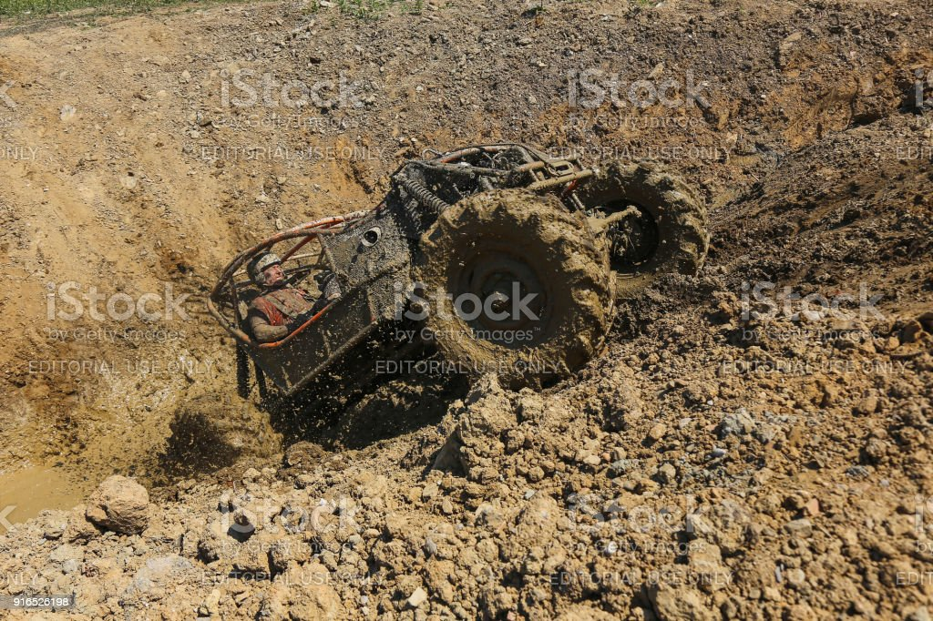 Offroad 4wd car driving uphill splashing mud and water stock photo