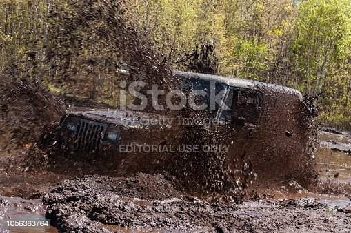 Goffs, Canada - Goffs, Canada - May 20, 2006 - A driver powers his Jeep through a deep bog during an annual off road event.