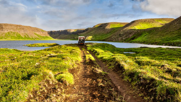 Offroad Camping Car in Bright Green Paradise Valley stock photo