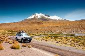 Altiplano, Bolivia - March, 27, 2017: Off-road car driving in the desert on Altiplano plateau, Bolivia