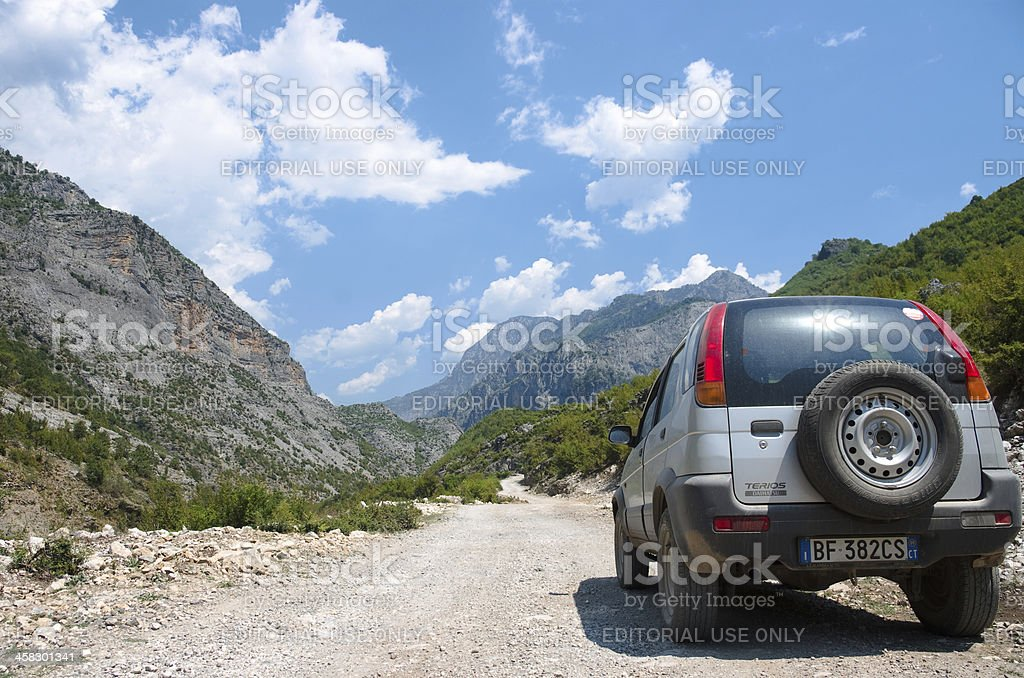 Off-road Car On Dirt Road Between Albanian Alps royalty-free stock photo