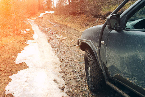 Off-road car on the dirty forest road. stock photo