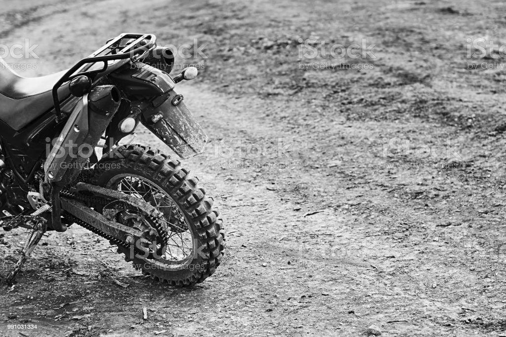 Single offroad mountain motorcycle or bike taking part in motocros...