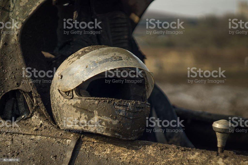 Offroad racer's helmet covered in mud Lizenzfreies stock-foto