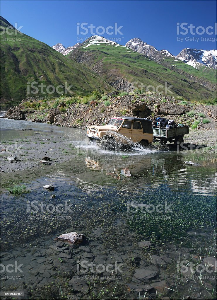 Off-road vehicle crossing the river royalty-free stock photo