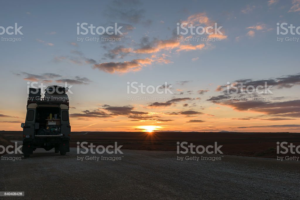 Off-road vehicle oldtimer sunset stock photo