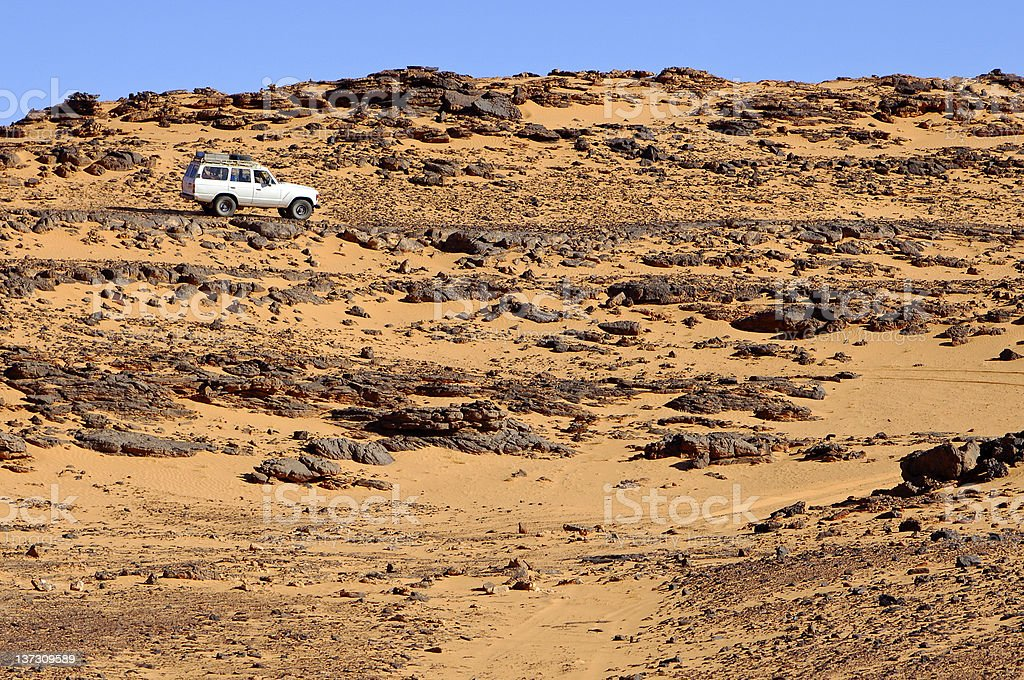Off-road vehicle on a rough desert road royalty-free stock photo