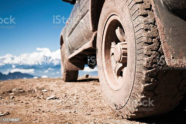 Photo of off-road vehicle on mountain peak