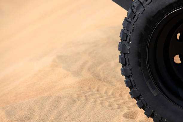 Off-road vehicle traveling in the desert stock photo