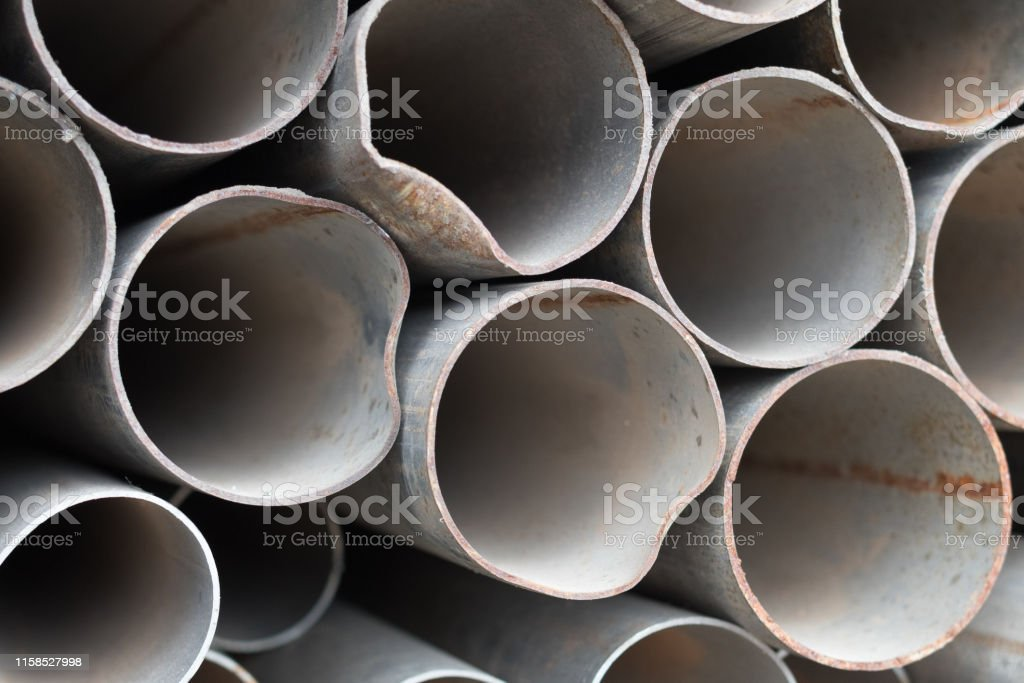 Offscouring. Old iron pipes. Background.