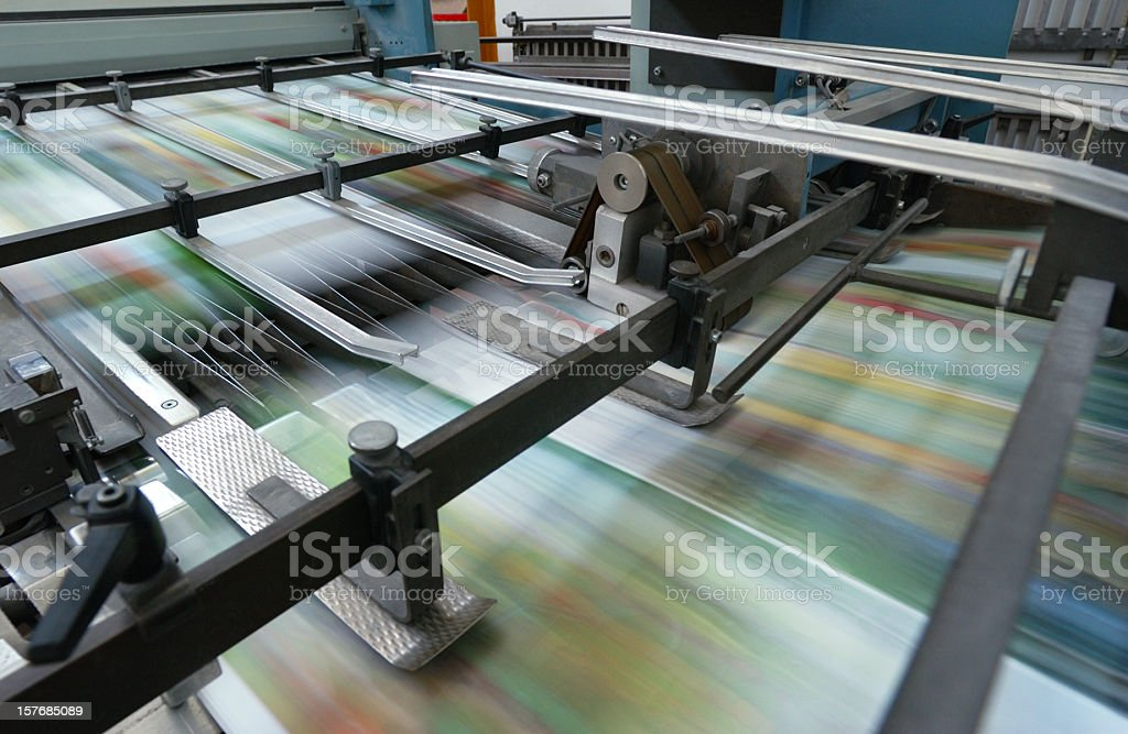 Offset printing machine while it's running, close-up royalty-free stock photo