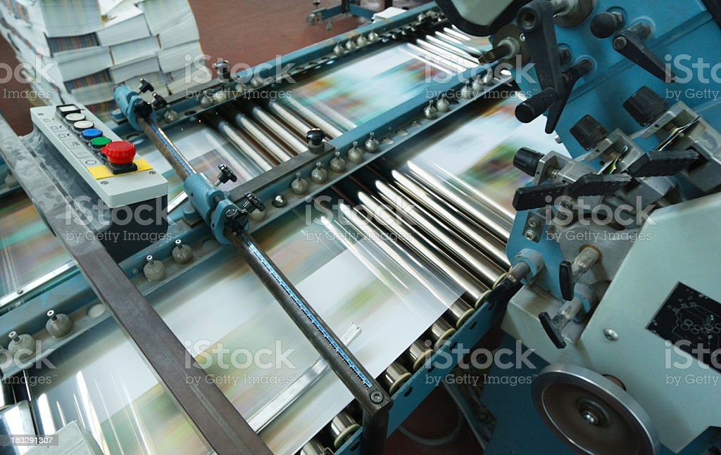Offset printing machine while it's running, view from above stock photo