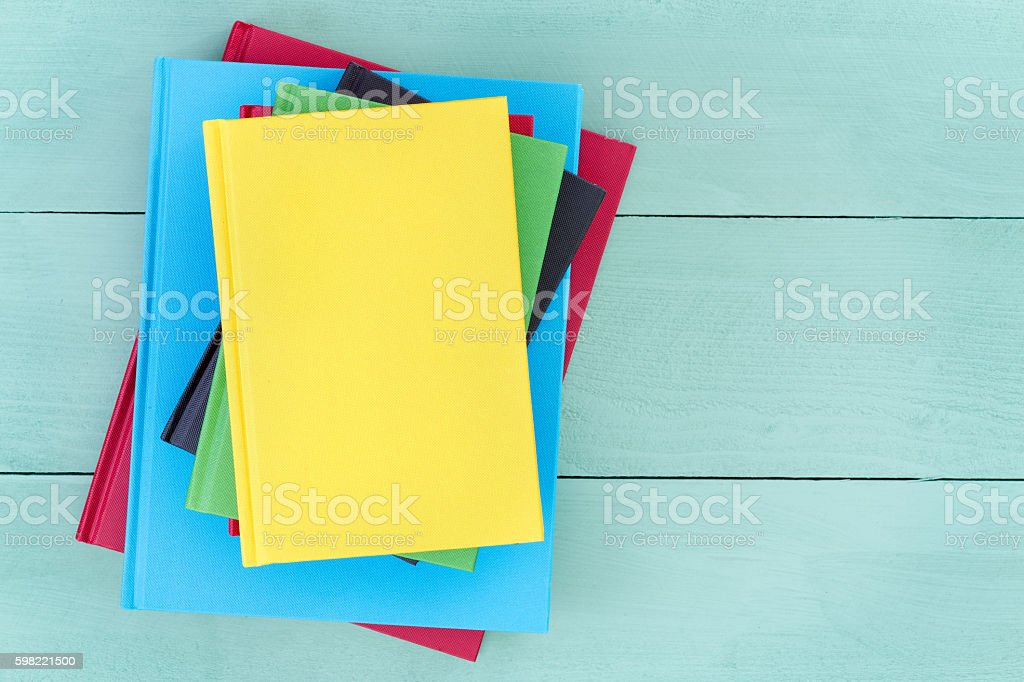 Offset stack of multicolored hardcover books stock photo