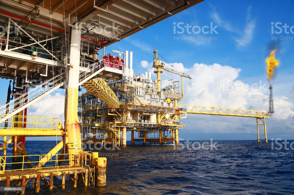 Offshore construction platform for production oil and gas. Oil and gas industry and hard work. Production platform and operation process by manual and auto function from control room. stock photo