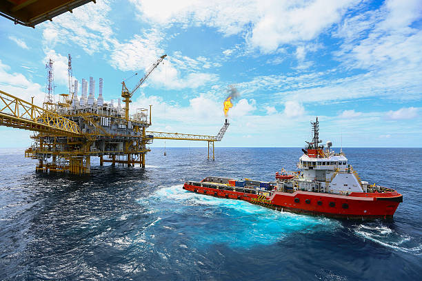 offshore construction platform for production oil and gas - crude oil stock photos and pictures
