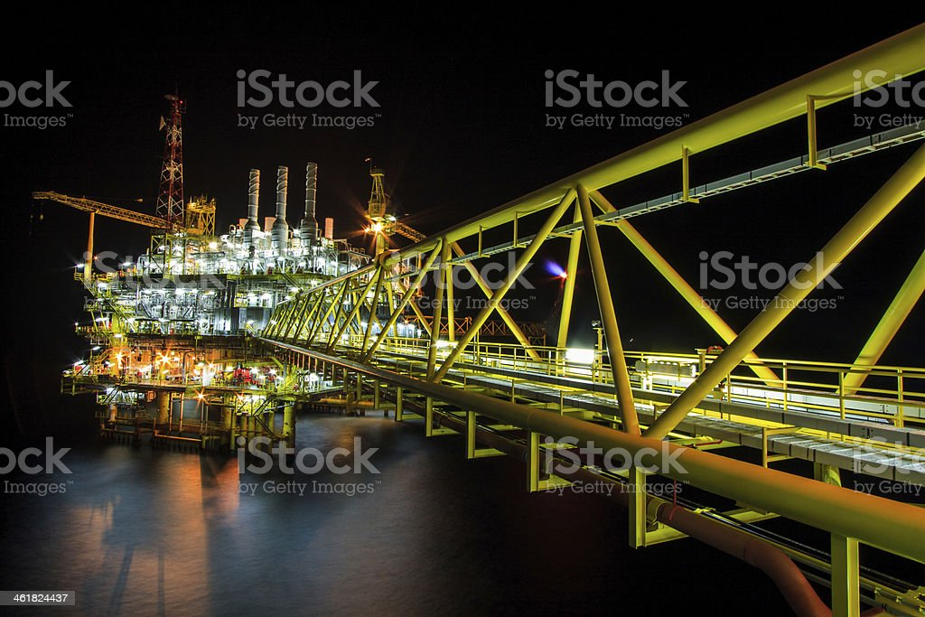 Offshore construction platform in night. stock photo