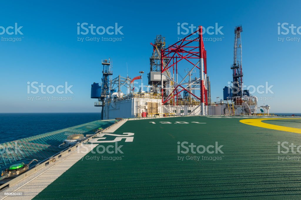 offshore drilling rig with helicopter deck stock photo
