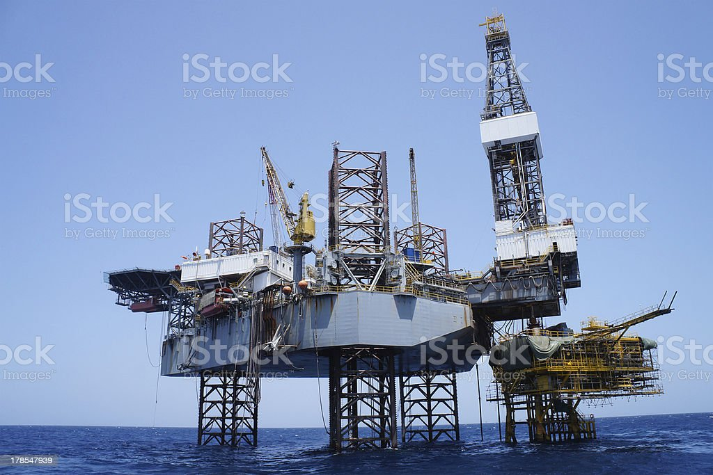 Offshore Jack Up Rig and The Production Platform royalty-free stock photo