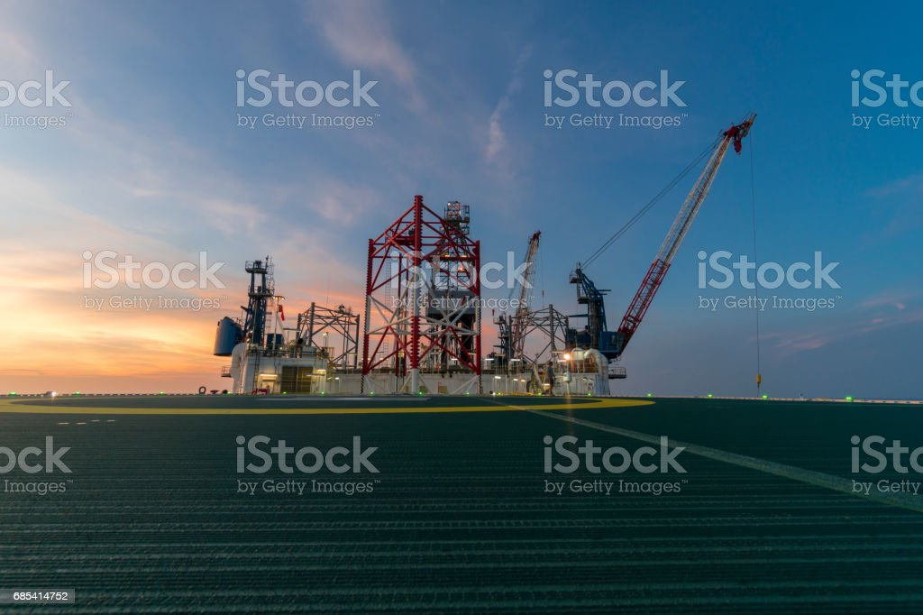 offshore jack up rig during twilight stock photo