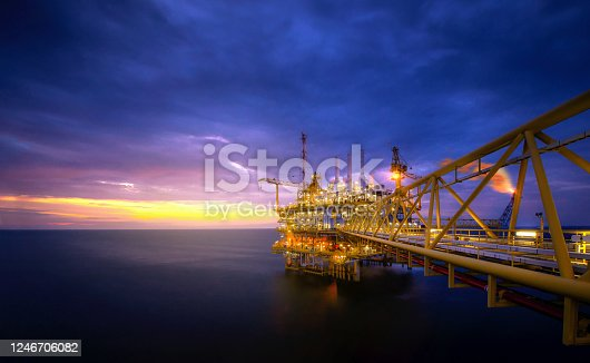 Industry of oil offshore jack up rig at gulf in the time after sunset.