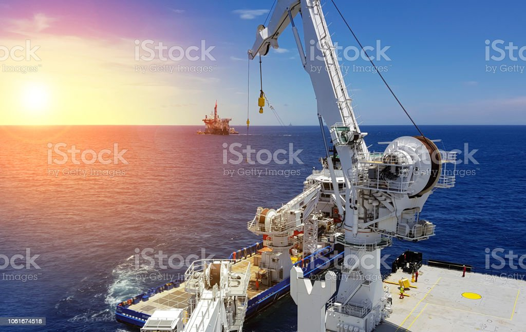 Offshore Lifting Operations At Sea Between Two Ships Stock
