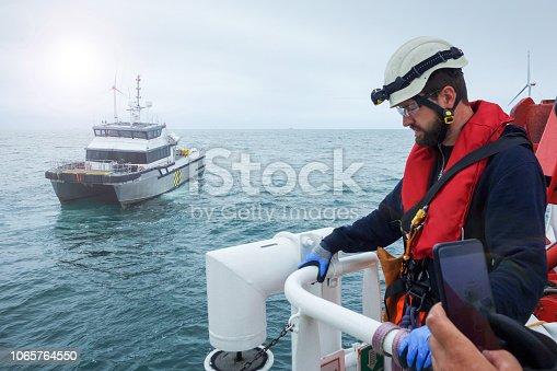 Wind-turbine, offshore, worker, climbing, sun, big, deck, vessel