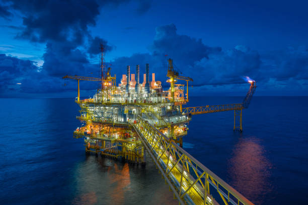 Offshore oil and Gas processing platform, oil and gas industry to treat raw gases and sent to onshore refinery, petrochemical and power generation plant stock photo