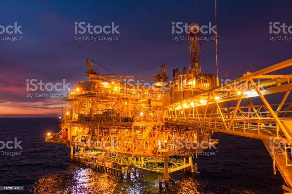 Offshore oil and gas rig platform with beautiful sunset time or...