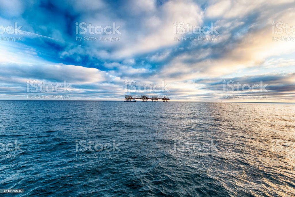 HDR offshore oil platform and supply ship stock photo