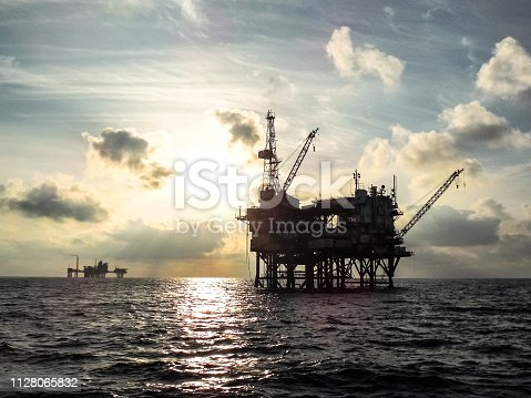 Offshore oil platform at sunset. Offshore oil platform at sunset.