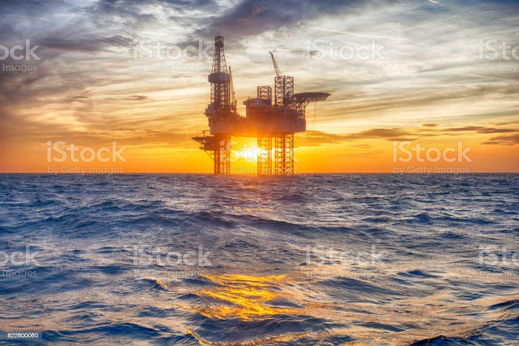 Offshore oil platform at sunset stock photo